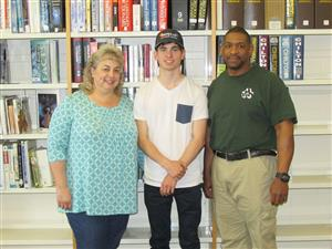Picture of J. Malone, Mom and instructor Mr. Pope