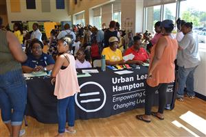 urban league and walmart host a book bag giveaway for over 500 students