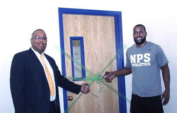 Mr. Eric Blackwell, Athletic Director at Bryant & Stratton College and Kam Chancellor did the honors of cutting the ribbon