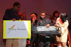 Ruffner student gifted instrument courtesy of HJ Lang Foundation