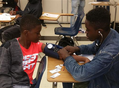 Students measuring blood pressure